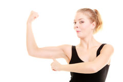 Fitness woman showing energy flexing biceps isolated Royalty Free Stock Photos