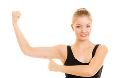Fitness woman showing energy flexing biceps muscles. Stock Image