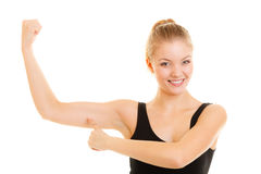 Fitness woman showing energy flexing biceps muscles. Stock Photography