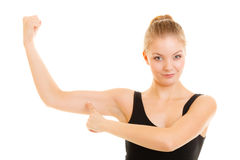 Fitness woman showing energy flexing biceps muscles. Royalty Free Stock Photography