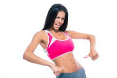 Fitness woman showing finger at her belly Royalty Free Stock Images