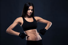 Fitness woman showing finger at her belly Stock Image