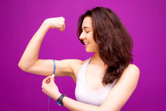 Fitness woman showing fresh energy flexing biceps muscles. Stock Photo