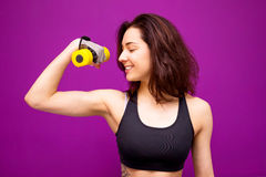 Fitness woman showing fresh energy flexing biceps muscles. Stock Image