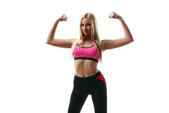 Fitness woman showing muscles Royalty Free Stock Images