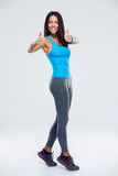 Fitness woman showing thumb up sign Stock Photo