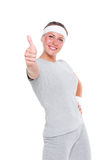 Fitness woman showing thumbs up Stock Image
