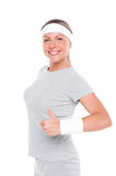Fitness woman showing thumbs up Royalty Free Stock Images