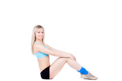 Fitness woman sitting Royalty Free Stock Photos