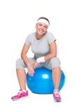 Fitness woman sitting on ball Stock Image