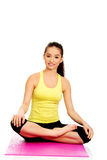 Fitness woman sitting on exercise mat. Royalty Free Stock Photography