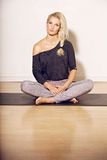 Fitness Woman Sitting on the Floor Royalty Free Stock Image