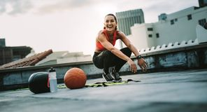 Happy fitness woman training on rooftop in the morning stock photo