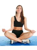 Fitness woman sitting in lotus yoga position Royalty Free Stock Photos