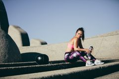 Fitness woman taking a break after exercise session Royalty Free Stock Photography