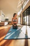 Fitness woman sitting Vajrasana yoga pose Stock Photo