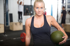 Fitness woman with slam ball at gym center Stock Photo