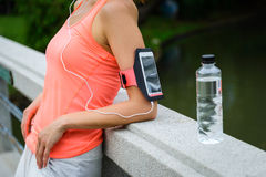 Fitness woman with smartphone armband ready for workout Royalty Free Stock Photography