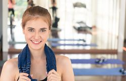 Fitness woman smiling with friend work out in the background. With copy space Royalty Free Stock Photos
