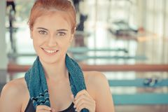 Fitness woman smiling with friend work out in the background. With copy space Stock Photography