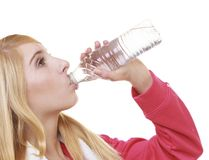 Fitness woman sport girl with towel drinking water from bottle isolated Royalty Free Stock Photography