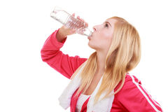 Fitness woman sport girl with towel drinking water from bottle isolated Stock Photo