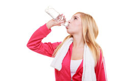 Fitness woman sport girl with towel drinking water from bottle isolated Stock Photos