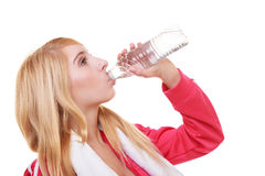 Fitness woman sport girl with towel drinking water Stock Photography