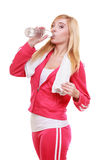 Fitness woman sport girl with towel drinking water Royalty Free Stock Images