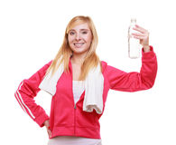 Fitness woman sport girl with towel and water bott Royalty Free Stock Image