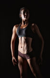 Fitness woman in sport style standing Stock Photography