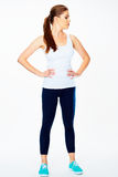 Fitness woman in sport style standing against white background Royalty Free Stock Photo