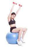 Fitness woman sport training with exercise ball and lifting weights Royalty Free Stock Photos