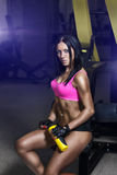 Fitness woman in sport wear with perfect sexy fitness body in gym Royalty Free Stock Photo