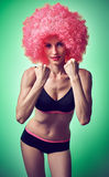Beauty fashion. Fitness woman smiling, athletic body, afro  Stock Photography