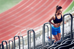 Fitness Woman on stadium. Warming up on stairs Royalty Free Stock Photography