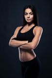 Fitness woman standing with arms folded Stock Photo