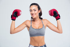 Fitness woman standing with boxing gloves in victory pose Royalty Free Stock Photography