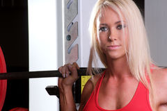 Fitness woman standing in the squat rack Stock Photo