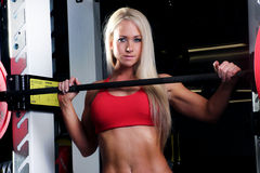 Fitness woman standing in the squat rack Royalty Free Stock Image