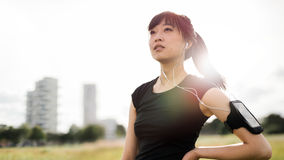 Fitness woman standing in urban park Stock Images
