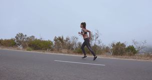 Fitness woman starting her run on countryside road stock footage