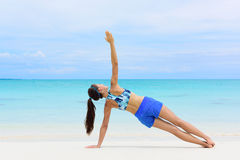 Fitness woman strength training core side plank stock photography