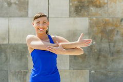 Fitness woman stretch befor exercises. Stock Photography