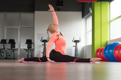 Fitness Woman Stretches At The Floor Stock Photography