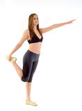 Fitness woman stretching. Pretty woman smiling an stretching Stock Photos