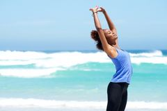Fitness woman stretching at the beach Royalty Free Stock Photos