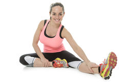 Fitness woman stretching full body over white background. Royalty Free Stock Photo