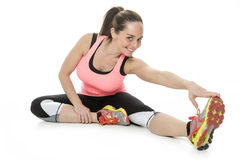 Fitness woman stretching full body over white background. Royalty Free Stock Images