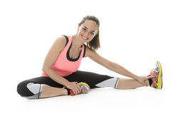 Fitness woman stretching full body over white background. Stock Images